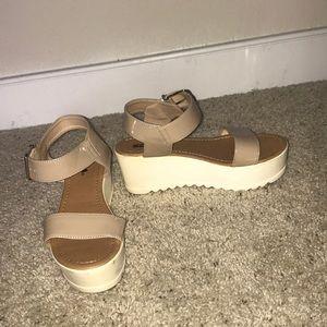 Platform sandals.